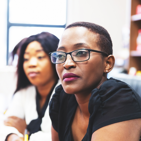 Black woman at a meeting.png