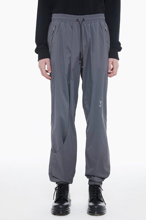 51 PERCENT Asymmetric Logo Trousers