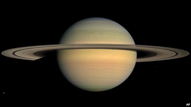 This July 23, 2008 image made available by NASA shows the planet Saturn, as seen from the Cassini spacecraft. A newly discovered a planet outside our solar system is 12 times the size of Jupiter.