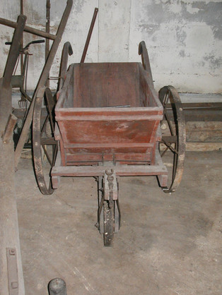 Spreader Cart; Circa 1800's. Horse-drawn wood with iron wheels. Used for spreading fertilizer.