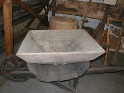 Early 1900's Funnel for the Corn Grist Mill from the Jerman Farm sitting in the 1700's wheelbarrow until the base can be picked up. Given to the Museum on 12/13/13.