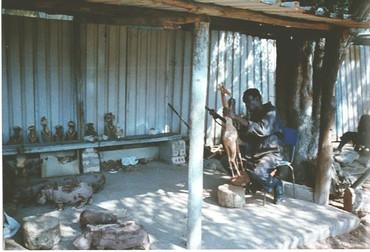 Zimbabwe - Woodcarver outside of Harare.