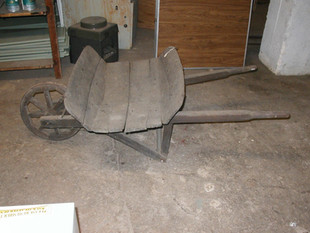 Wheelbarrow; all wood. Later 1700's. Made from barrel staves.