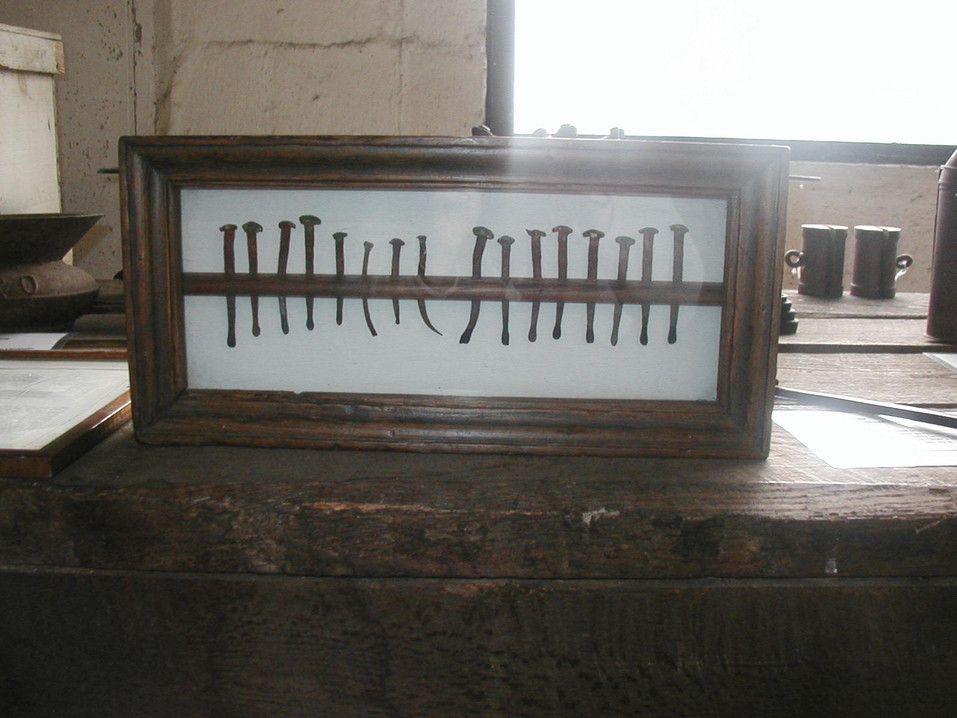"""16 Nails, 1700's-1800's. Hand-made """"rose head"""" nails taken from old slave quarters on Somerset plantation."""