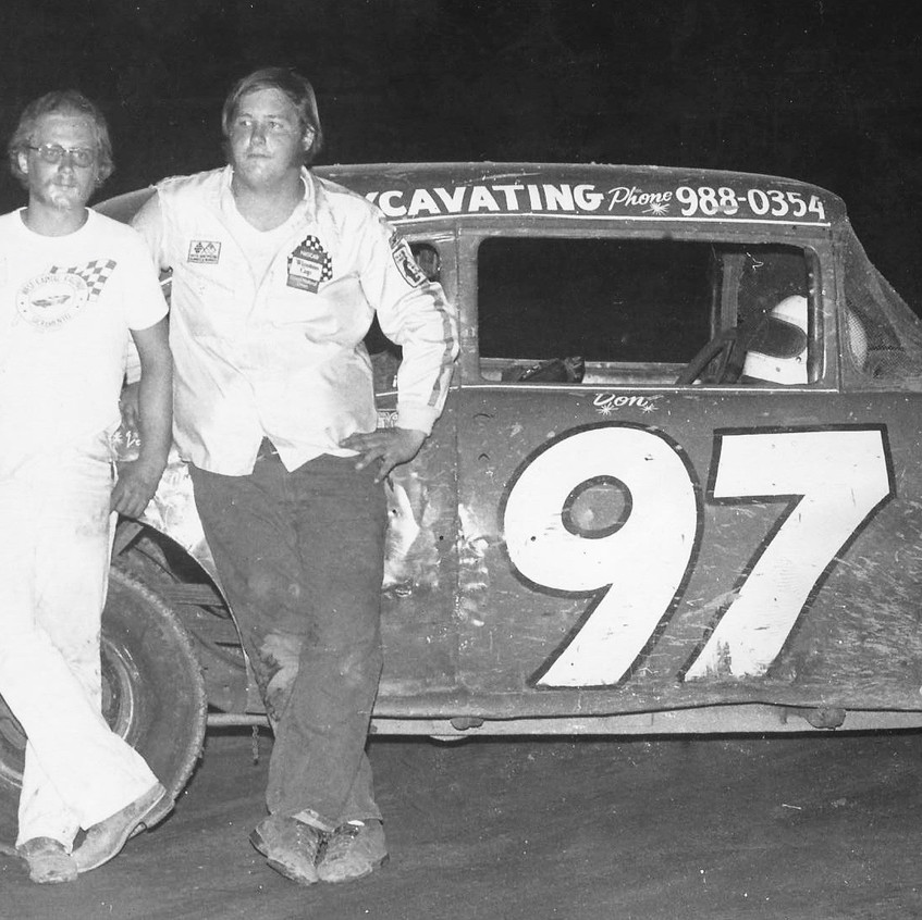 DT and Ron Tilford posing next to   97 chevy - 1