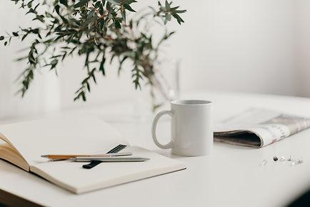 white-ceramic-mug-on-white-table-4065894