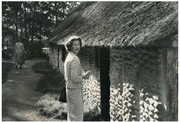 Mary Zimbalist : Photographs : Mary outside hut