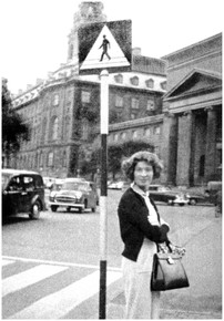 Mary Zimbalist : Photographs : Mary in front of street sign