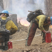 wildland firefighters hotshot crew members prepare for burning operations on the fireline