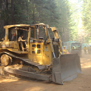 bulldozer and firefighters on the fireline