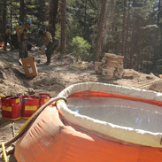 wildland firefighter equipment portable water tank on the fireline