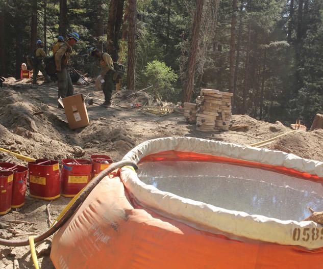 wildland firefighter equipment portable water tank on the fireline