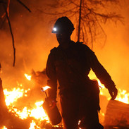 wildland firefighter hotshot crew member uses a drip torch