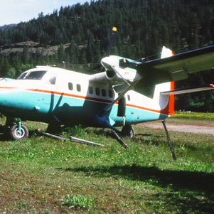 Broken Twin Otter after crash landing at Minam R. ranch, Eagle Cap Wilderness