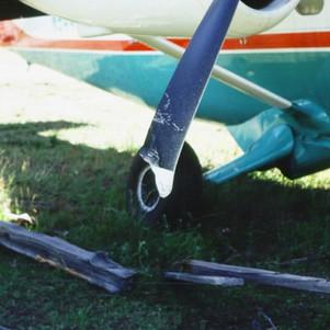 Broken landing gear and propeller at Minam R. Ranch