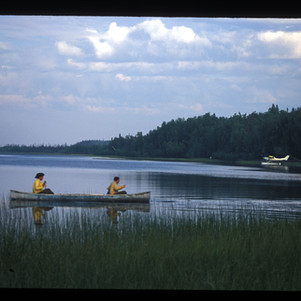 Loaner canoe on Mucha L. cabin protection jump
