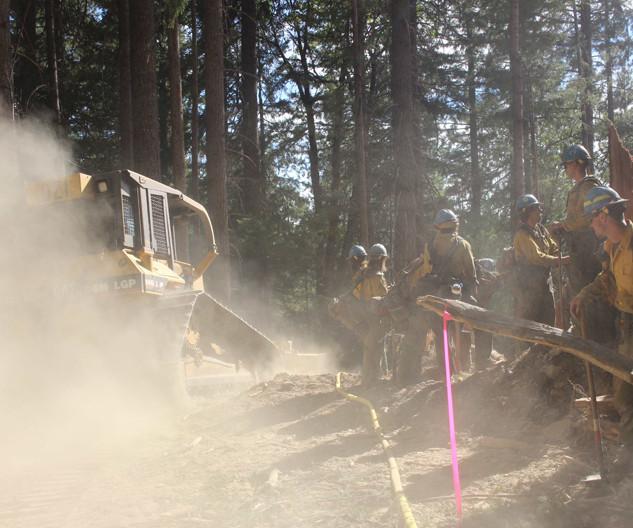 bulldozer constructs fireline