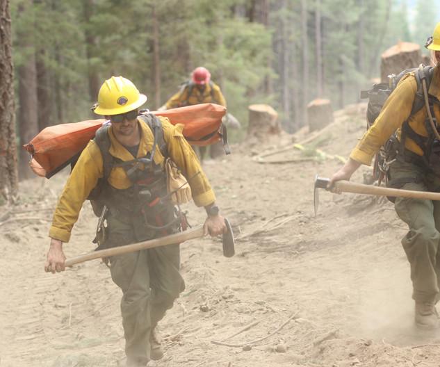 wildland firefighters rapid extraction module REM medics hike the fireline