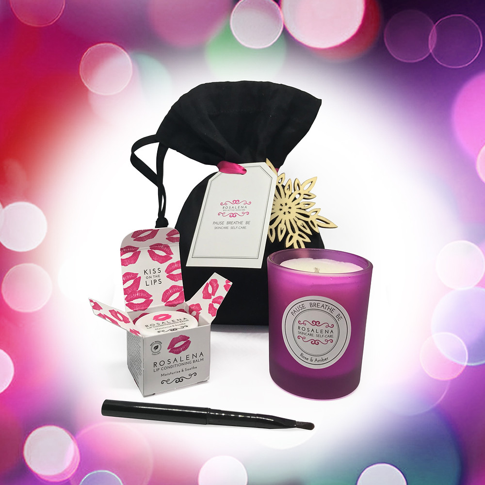 A Let It Glow Candle Gift Set from Rosalena Skincare