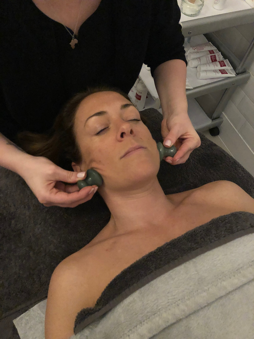 Jade Gua Sha Stones during a Rosalena FaceFit Treatment at All About The Girl