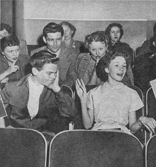 Caption: ' Don't get notions you're a singer when the star begins her song. You may love to hum and warble, but the crowd won't stand it long!'