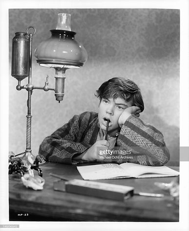 bobby-driscoll-with-pen-in-mouth-in-a-scene-from-the-film-when-i-grow-picture-id148296943.