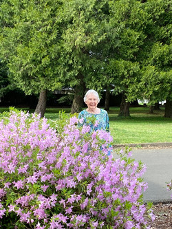 Jean Rogers inspecting our beautiful blooms outside the church offices