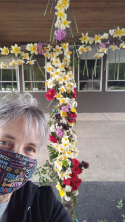 Leanna Deters taking a peek at the Easter Flower Cross - 2021
