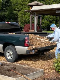 Gary Medsker unloading bark for the church grounds