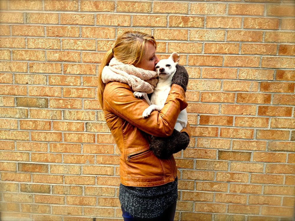 Women hugging dog