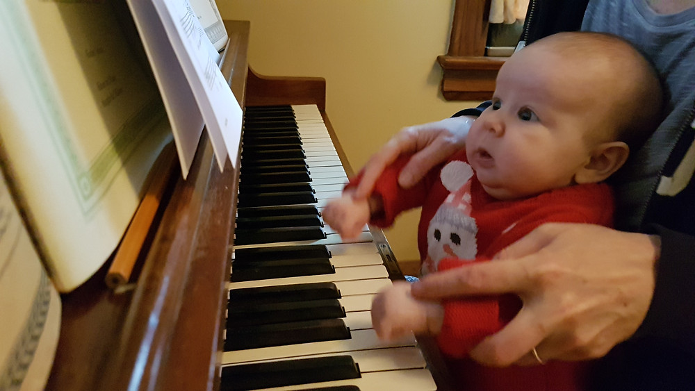 Mom and baby playing piano