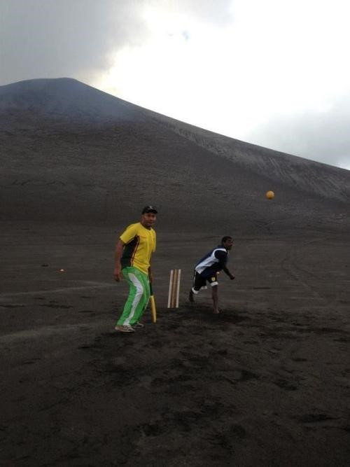 Cricket being played on the ash plains of Mt. Yasur in 2015.