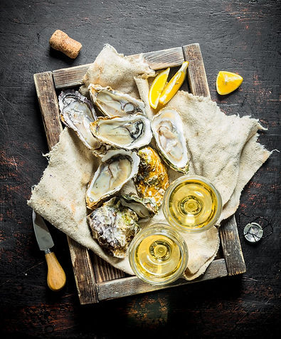 raw-oysters-rag-wooden-tray-with-glasses-white-wine-dark-wooden-table (1).jpg