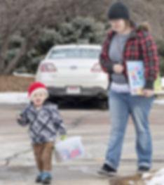 Child returning Toy Lending Library box
