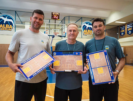 "Alba Berlin Haed coach ""Aito"" Garcia Reneses posing with  coachboard products."