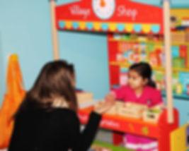 Staff doing shop role play at Sahan Nurser