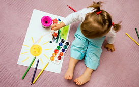 Children painting Sahan Nursery
