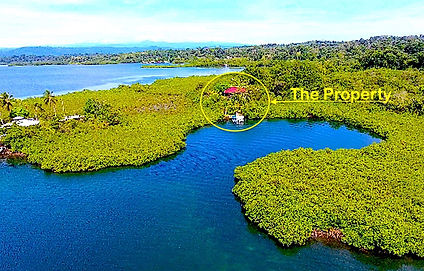 Titled Land w/two-story House in Dolphins Bay, Caribbean Sea
