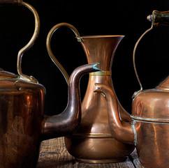 Copper kettles and vase