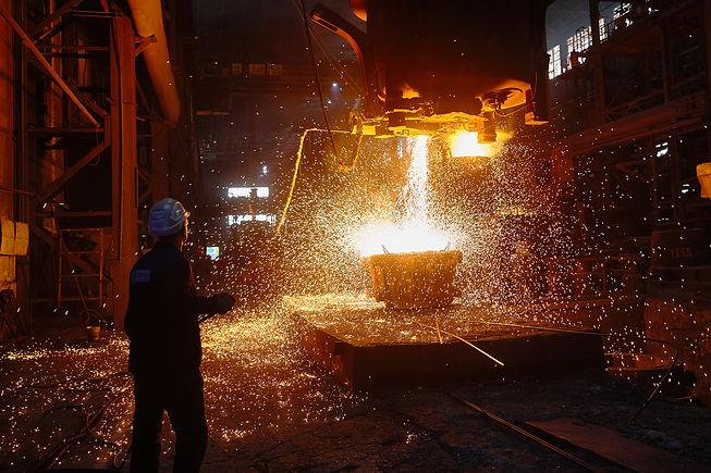 Steelmaker at ingot casting. Electric ar