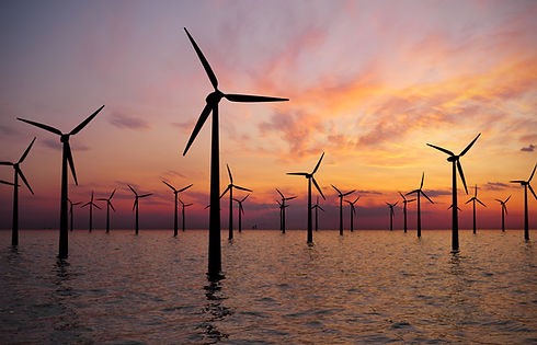 Offshore Wind Turbines Farm At sunset.jp