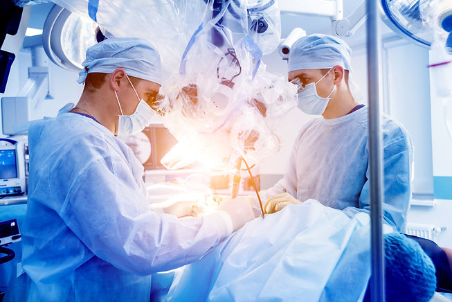 Spinal surgery. Group of surgeons in ope