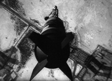 Image from 1964 movie, Dr. Strangelove, of Major TJ Kong riding the bomb down to the ground.