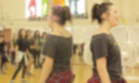 A dance reacher teaching children at a high school