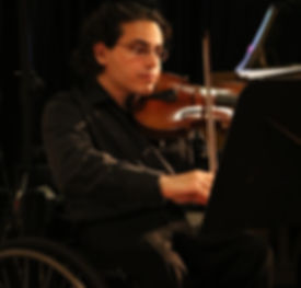 Man playing a violin during a performance