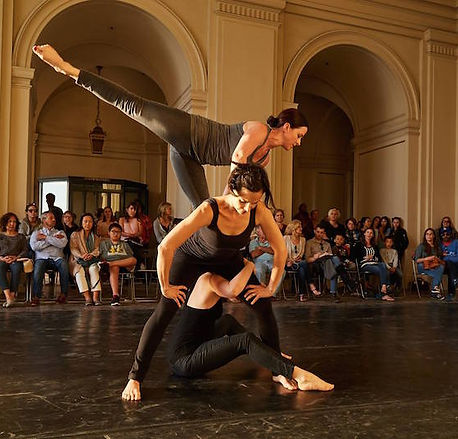 3 dancers performing at the Pasadena City hall, with audience around them