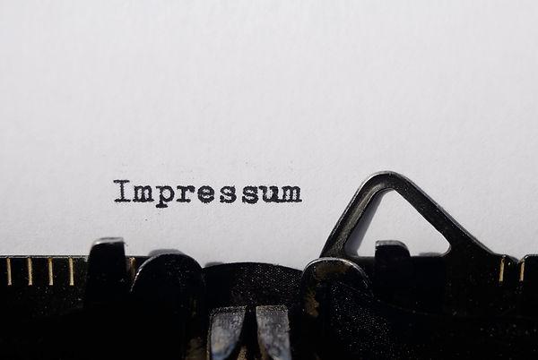 the word impressum on old typewriter.jpg