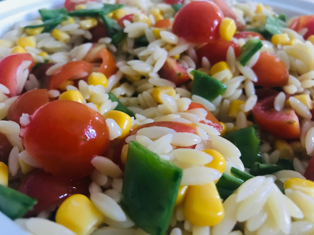 orzo pasta with cherry tomatoes sweetcorn and mangetout
