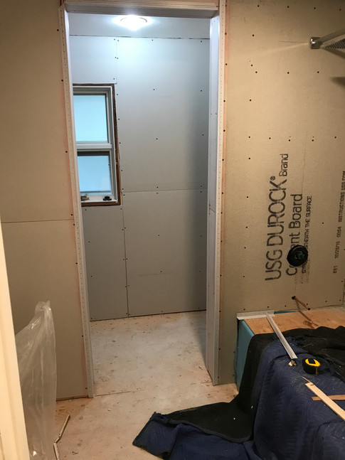 Drywall and cement board installed.