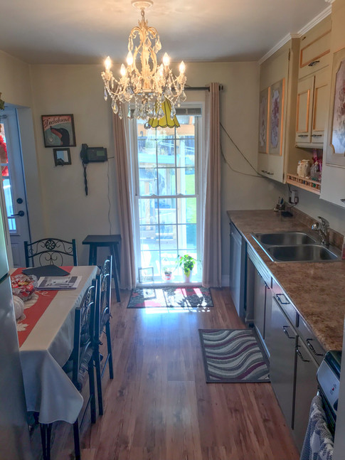 The client asked me to help open up and maximize the space in her tiny kitchen. There was a stairway on one side and bathroom on the other, so expanding wasn't an option.